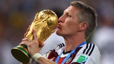 Bastian Schweinsteiger kisses the World Cup in 2014