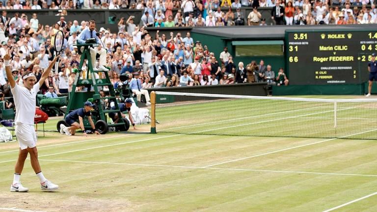 Roger Federer celebrates winning Championship point against Marin Cilic
