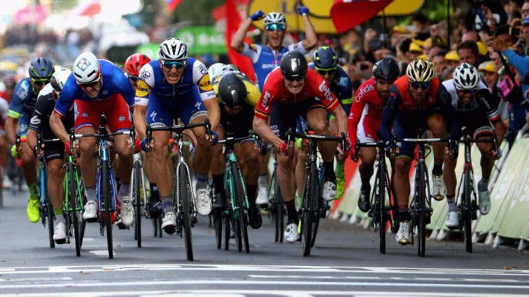 Andre Greipel (centre, red) will be desperate for victory