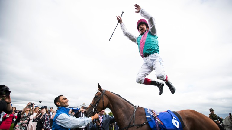 Frankie Dettori with his trademark flying dismount after winning the Irish Oaks