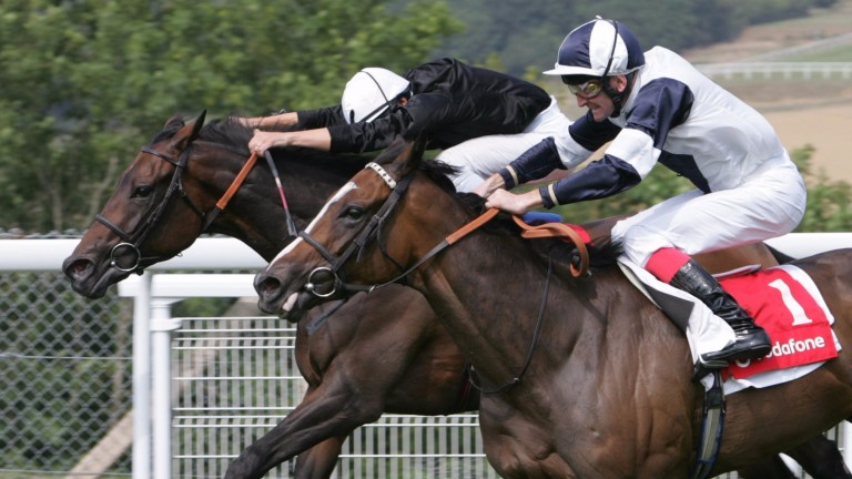 Ouija Board (black silks) and Alexander Goldrun fight out an epic race for the 2006 Nassau Stakes at Goodwood