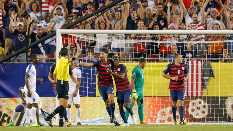 USA celebrate a goal against Martinique in the group stages