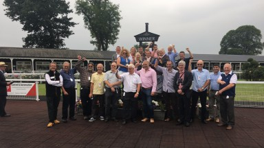 Foxtrot Racing members celebrate the victory of Supreme Steel at Uttoxeter
