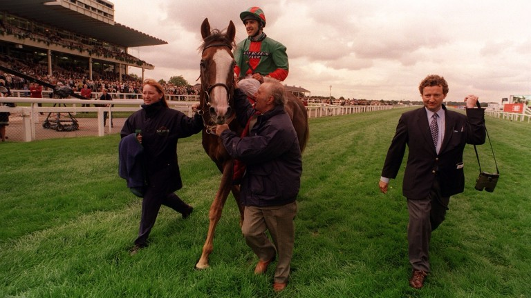 Double Trigger and Darryll Holland are led in after landing the 1998 Doncaster Cup
