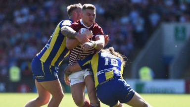 George Williams on the charge for Wigan against Warrington