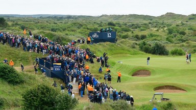 Si Woo Kim putts in front of the packed galleries at Birkdale