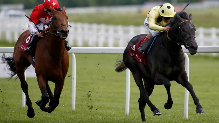 Defoe (right) keeps on strongly to win the London Gold Cup