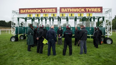 The team leader of the Racetech stalls handlers at Newbury, Arnie Jones (centre,black tie) leads a minutes silence in honour of the memory of Steve Yarborough, the stalls handler who died at Haydock on FridayNewbury 22.7.17 Pic: Edward Whitaker