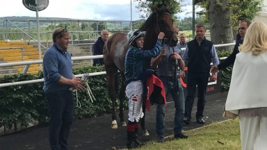 Insayshable and connections after his victory in the conditions race at Gowran Park