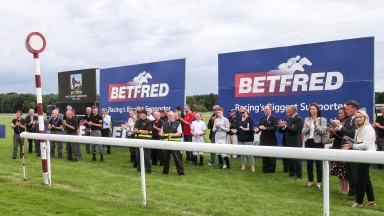 Racecourse Stall Team joined by jockeys, valets, BHA Starters and officials join together with with the Haydock Park Staff  at the winning post to remember STEPHEN YARBOROUGH - Haydock Park 22/7/17Photograph by Grossick Racing Photography 0771 046 1723