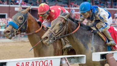 Abel Tasman (Mike Smith, red silks) holds off Elate in a tight finish to the Coaching Club American Oaks at Saratoga