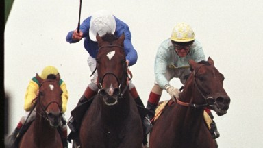 Swain toughs it out from Pilsudski (right) and Helissio under John Reid to land the star-studded 1997 King George