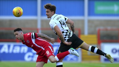Stirling's William Robertson challenges Inverness's George Oakley