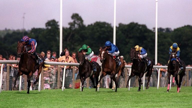 Mick Kinane glances at the big screen as Montjeu eases clear of Fantastic Light (blaze) and Daliapour in the 2000 King George VI and Queen Elizabeth Stakes
