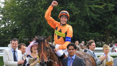 Richard Hughes returns in triumph after winning the 2010 Sussex Stakes on Canford Cliffs