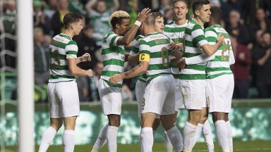 Celtic celebrate a goal against Linfield in the second qualifying round
