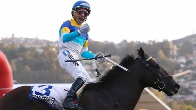 Jockey Juan Villagra celebrates Sixties Song winning Chile's Longines Gran Premio Latinoamericano at Valparaiso