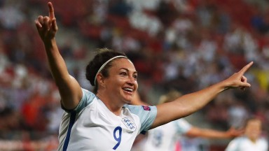 Jodie Taylor celebrates her treble against Scotland