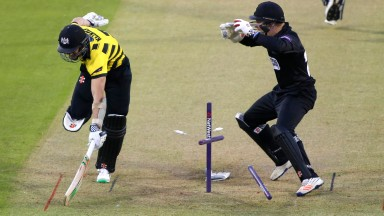 Sussex wicketkeeper Ben Brown tries to run out Michael Klinger of Gloucestershire