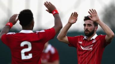 Graeme Shinnie celebrates scoring for Aberdeen