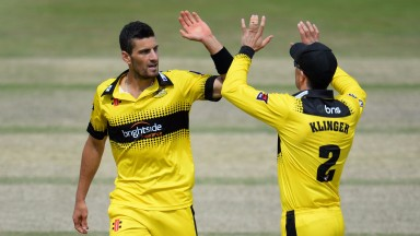 Benny Howell and Michael Klinger celebrate one of Howell's four wickets against Kent