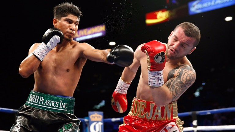 Mikey Garcia (left) lands a punch on the way to taking Dejan Zlaticanin's WBC lightweight title