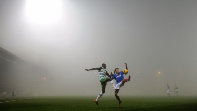 Yeovil's Bevis Mugabi competes for the ball during the wintry 0-0 draw with Portsmouth