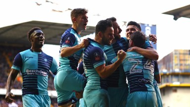 Wycombe celebrate Paul Hayes's penalty in the FA Cup defeat at Tottenham