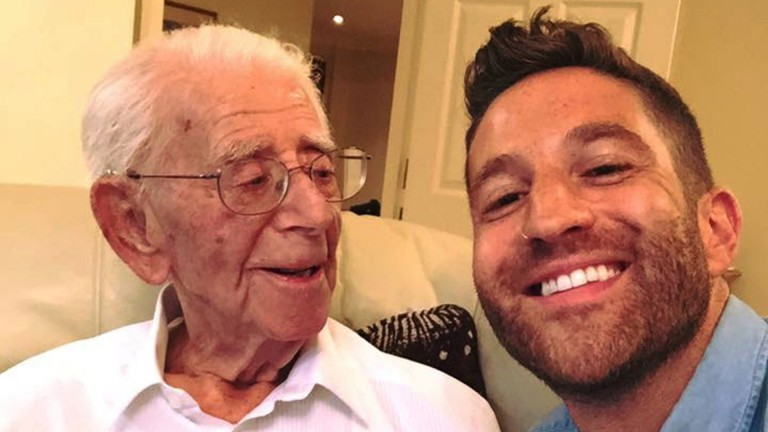 Jack Fisher, pictured celebrating with grandson Joel after turning 100