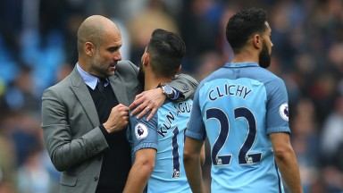 Pep Guardiola embraces Sergio Aguero