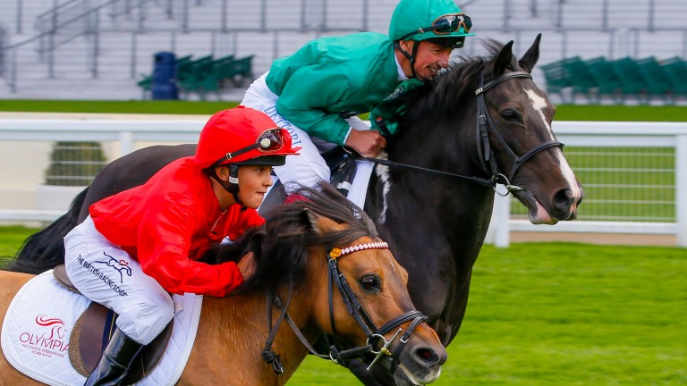 Frankie Dettori takes his son Rocco to new heights at Ascot Racecourse  ahead of them both riding at Olympia,The London International Horse Show.  Frankie  is looking to  retain his title in the Markel Champions Challenge in aid of the Injured Jockeys Fun