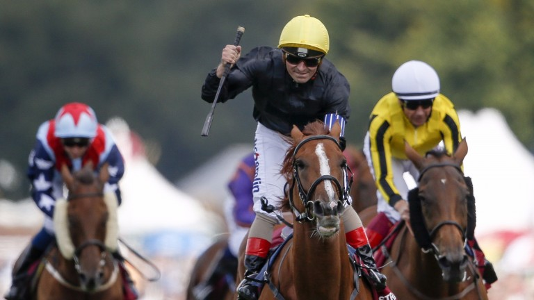 CHICHESTER, ENGLAND - AUGUST 01: Andrea Atzeni celebrates after riding Stradivarius to win The Qatar Goodwood Cup series from Big Orange (R, yellow) on day one of the Qatar Goodwood Festival at Goodwood racecourse on August 1, 2017 in Chichester, England.