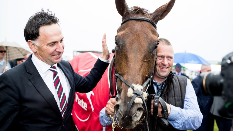Henry de Bromhead gives Balko Des Flos a pat following his six-year-old's victory in the Galway Plate