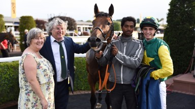 Claire and Alby Mills with Baltic Prince after a victory at Chester; also pictured are groom Imran and winning amateur rider Ben James