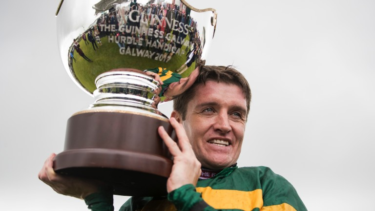 Overdue success: Barry Geraghty holds the Galway Hurdle trophy aloft after winning the race for the first time