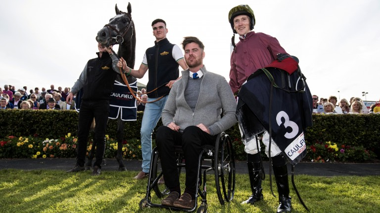 Galway: Robbie McNamara (centre) and Billy Lee celebrate Cascavelle's victory in the seven furlong maiden