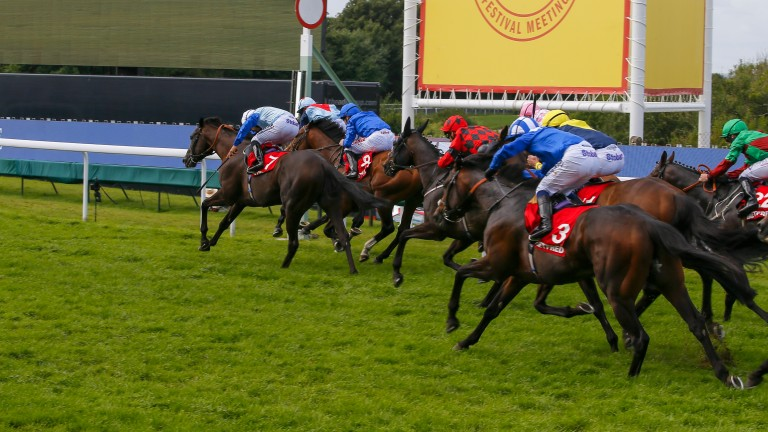 Marvellous Moore: Ryan Moore (light blue cap, second left) squeezes up the blindside on Master The World in the Betfred Mile to complete a hat-trick of wins on day four