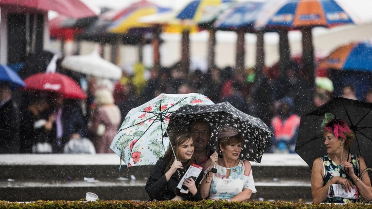 Racegoers sheltering from the rain at Galway