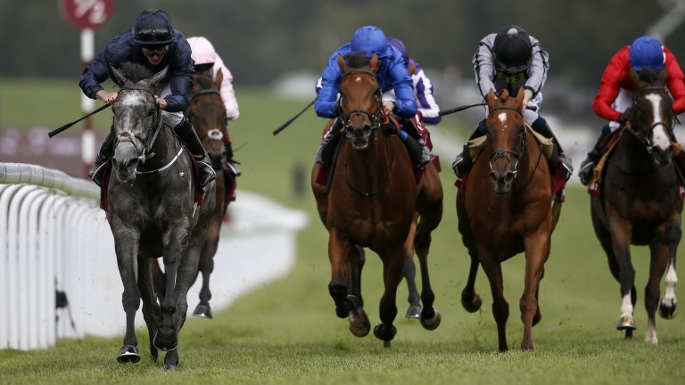 Goodwood: Ryan Moore and Winter (left) en route to winning the Nassau Stakes – the 100th Group 1 winner ridden by the jockey