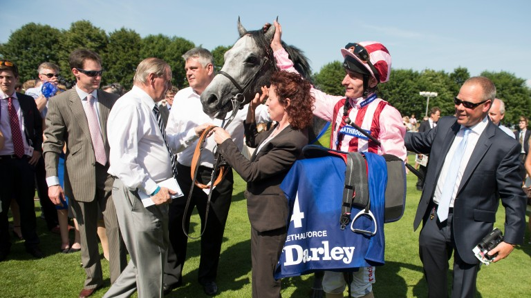 Clive Cox (right) greets Lethal Force as the son of Dark Angel returns to the winners' enclosure after landing the 2013 July Cup