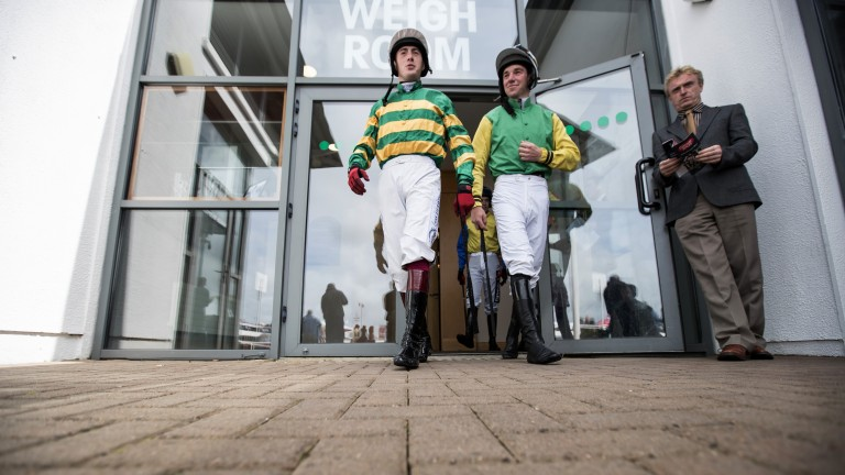 Heading out: Patrick Corbett (right) and Shane Shortall leave the weigh room ahead of the opener on the final day of the festival