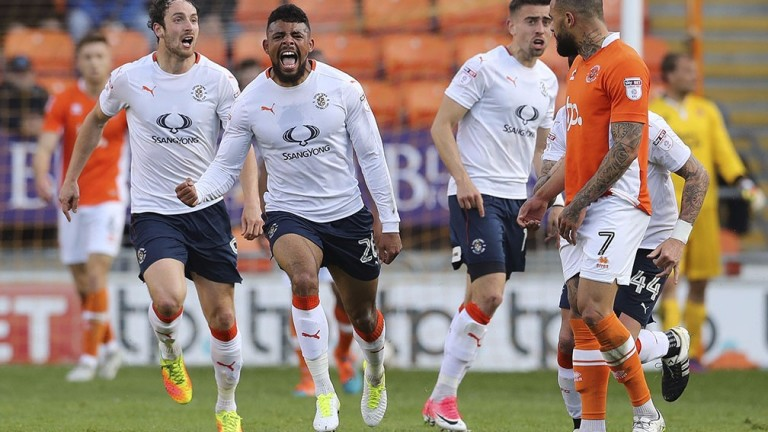 Isaac Vassell celebrates scoring for Luton against Blackpool in May