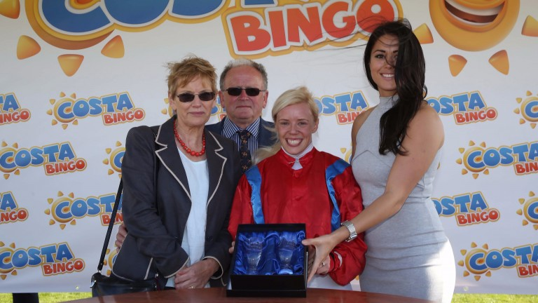 Olympian Sam Quek presents the prize to Cliff's owners Mr and Mrs Burton, and jockey Faye McManoman