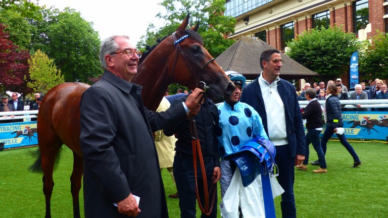 Jean-Claude Rouget and Cristian Demuro flank Olmedo after winning the Prix de Crevecoeur by four lengths at Deauville in August