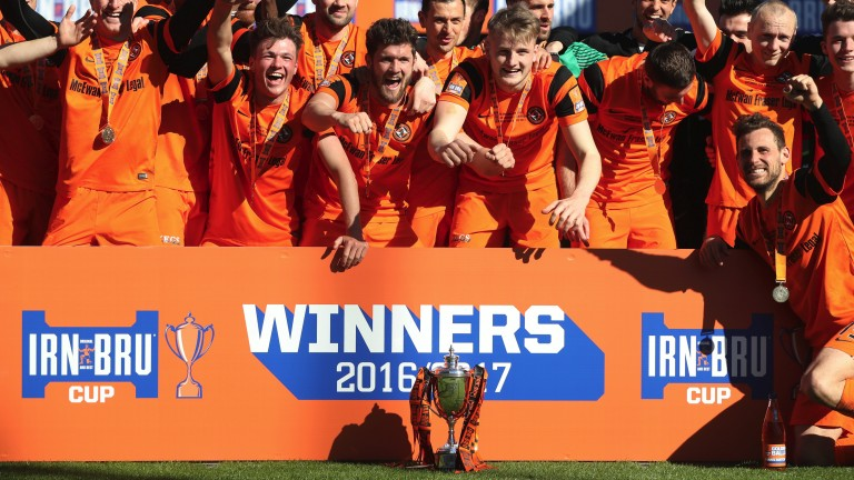 Dundee United celebrate with the Challenge Cup in March