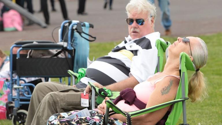 Brighton Festival scene: racegoers make the most of the sunshine before the rain set in