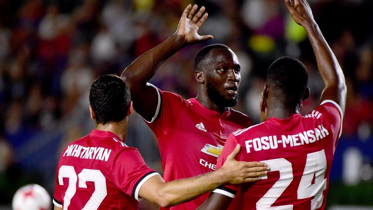 Romelu Lukaku celebrates with his new Manchester United teammates during preseason