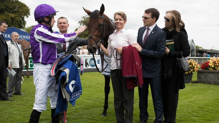 First success: Ryan Moore gives Mendelssohn a pat after victory in the 1 mile maiden