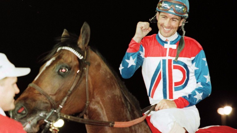 Jerry Bailey celebrates after winning the Dubai World Cup on the mighty Cigar