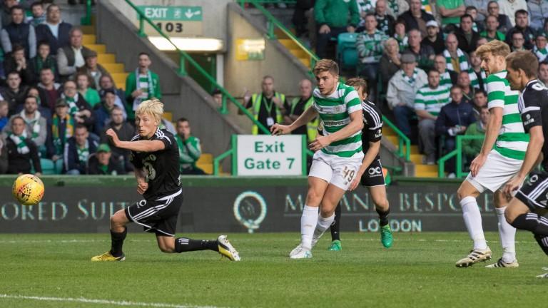 James Forrest takes a shot for Celtic against Rosenborg